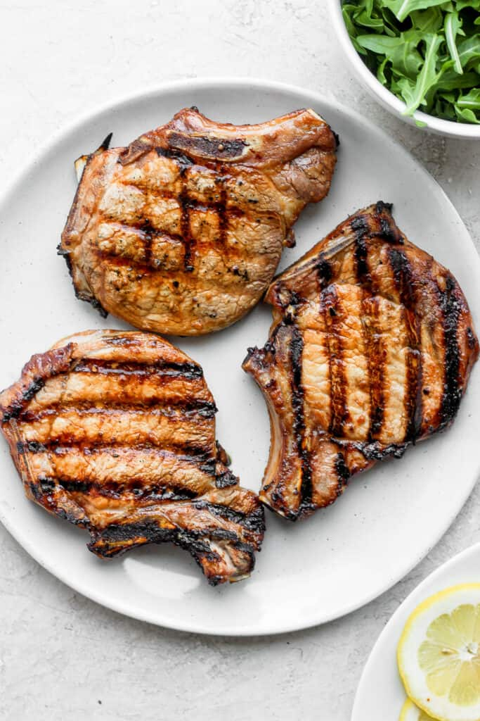 3 grilled pork chops on plate
