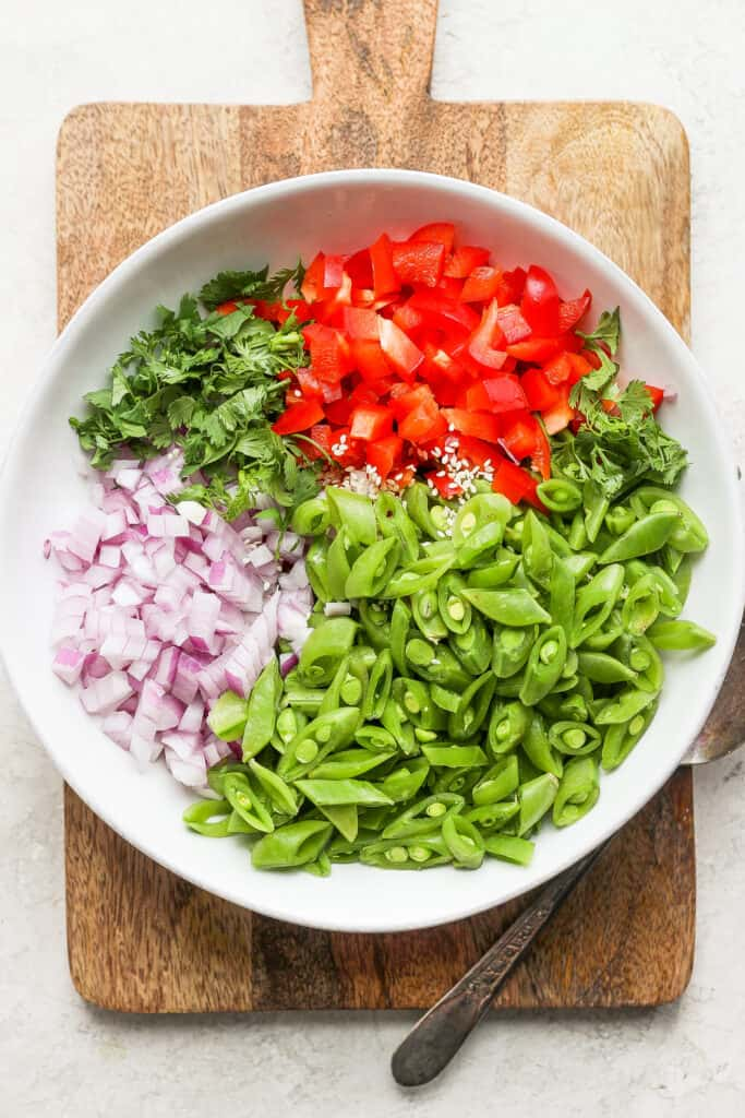 Ginger pea salad ingredients in a bowl.