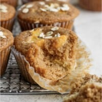 peach muffin with a bite taken out of it