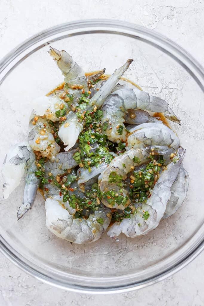 raw shrimp marinating in bowl