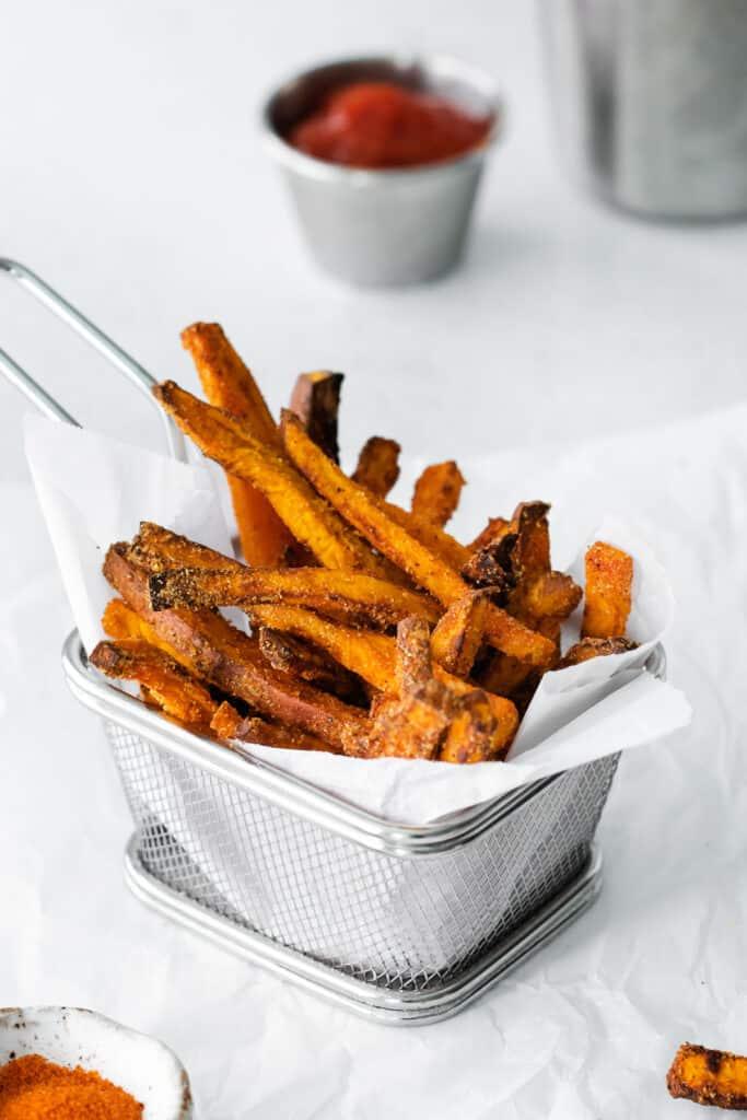 air fryer sweet potato fries in a fry basket