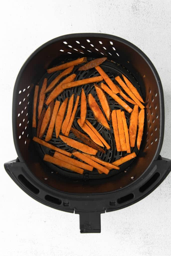 air fryer sweet potato fries in the air fryer basket