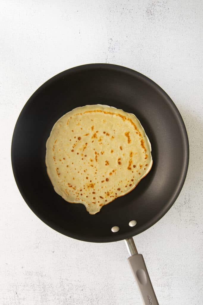 A crepe in a nonstick pan.