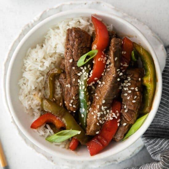 Pepper steak sprinkled with sesame seeds.