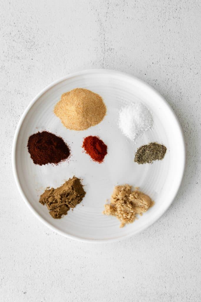 ingredients for steak taco seasoning on a plate