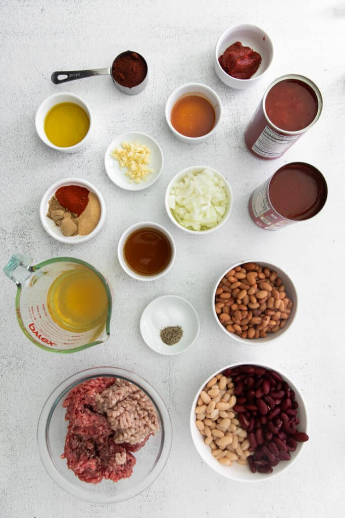 instant pot chili ingredients in bowls ready to be mixed together