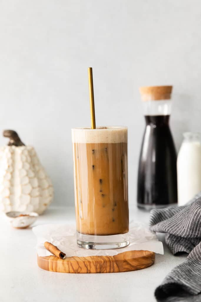 Pumpkin Cream Cold Brew mixed up in a tall glass.