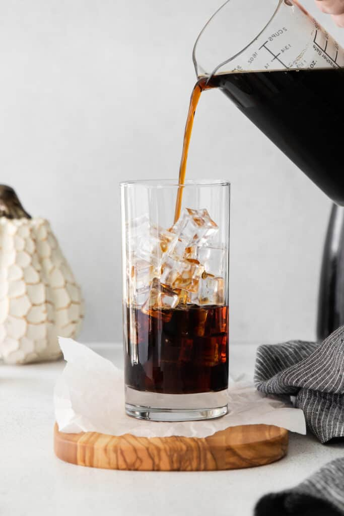 Pouring cold brew over ice.