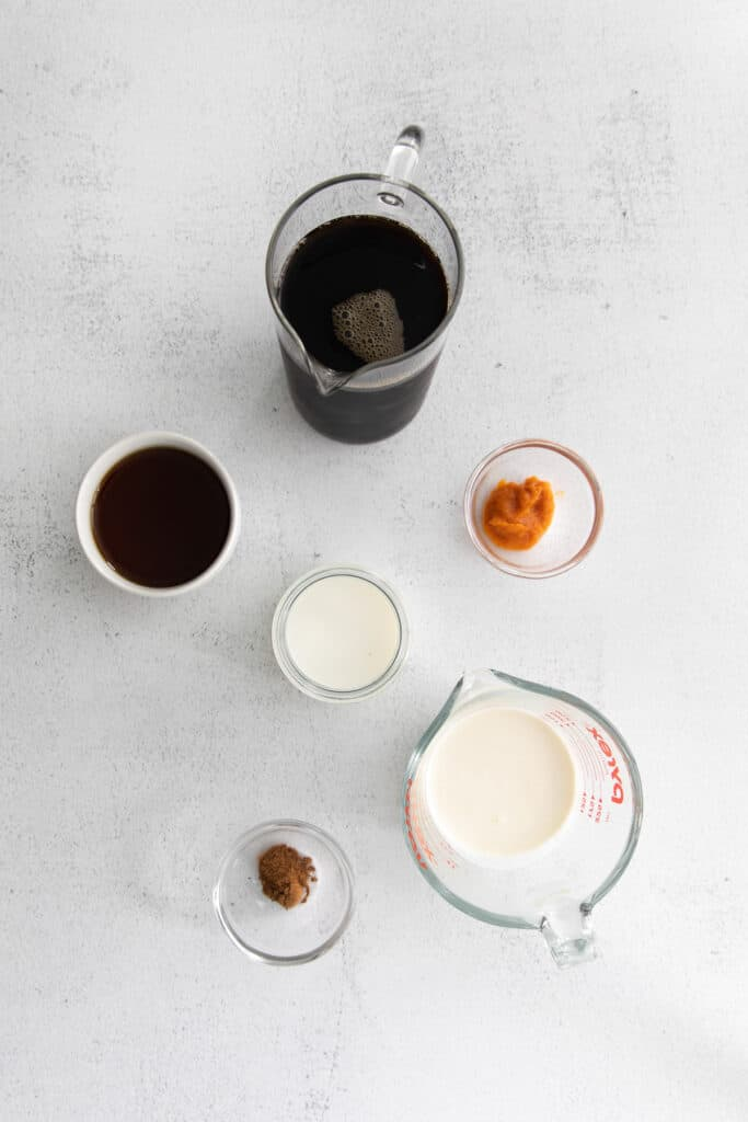 Pumpkin Cream Cold Brew ingredients in small containers.