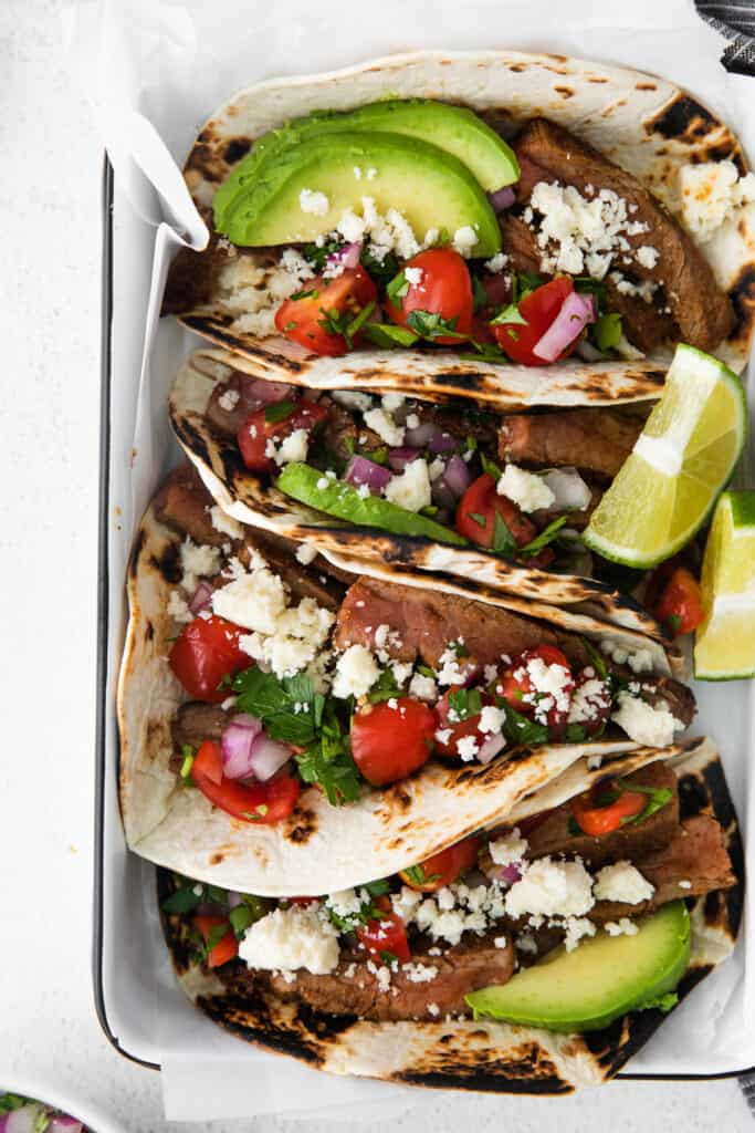 steak tacos side by side ready to be served