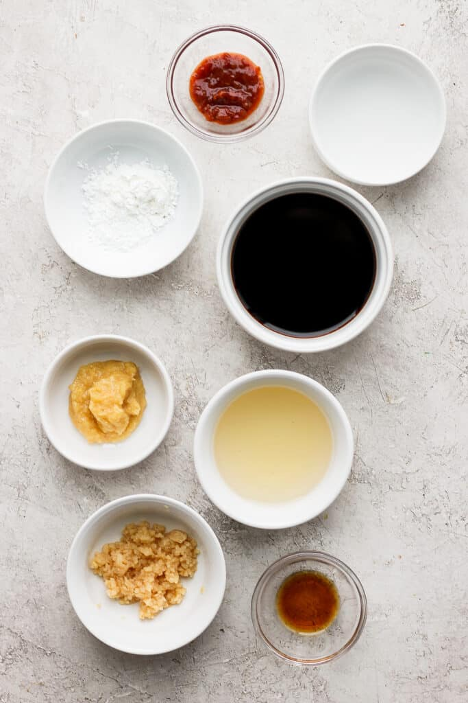 stir fry sauce ingredients in bowls ready to be mixed together