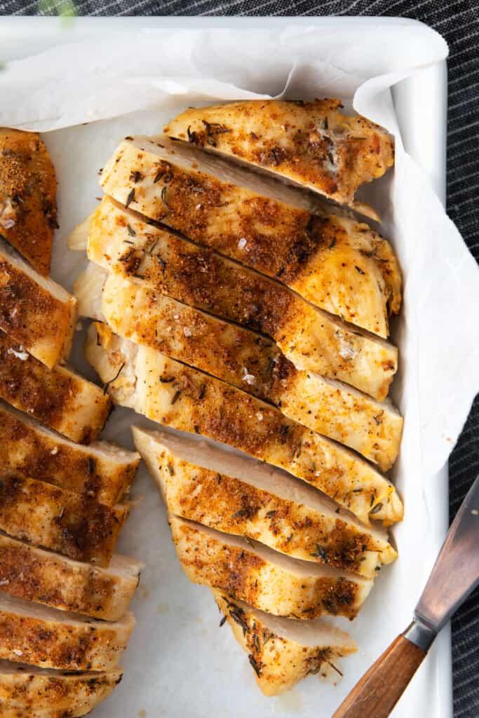 chicken breast sliced in dish