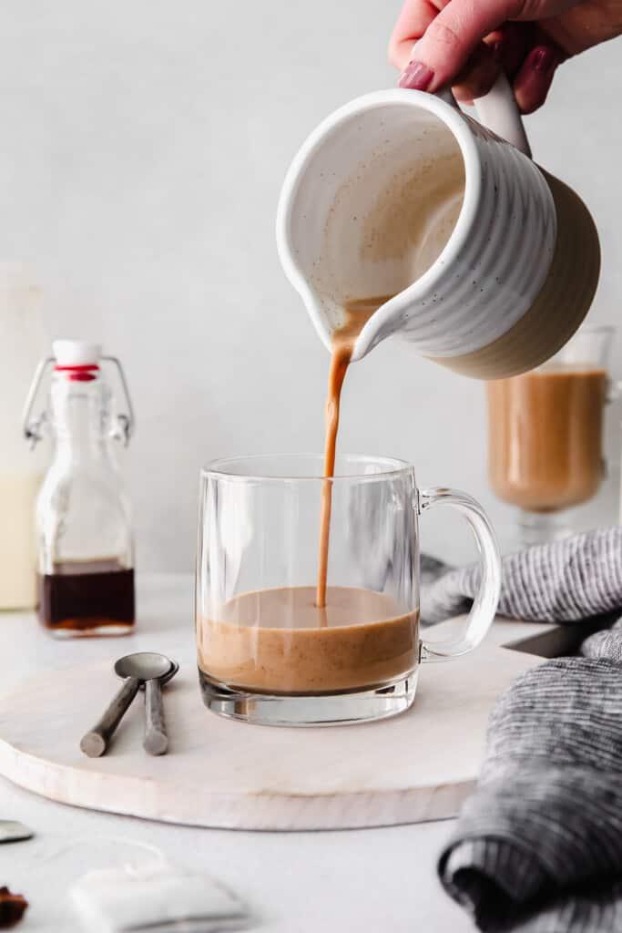 pouring chai tea into mug
