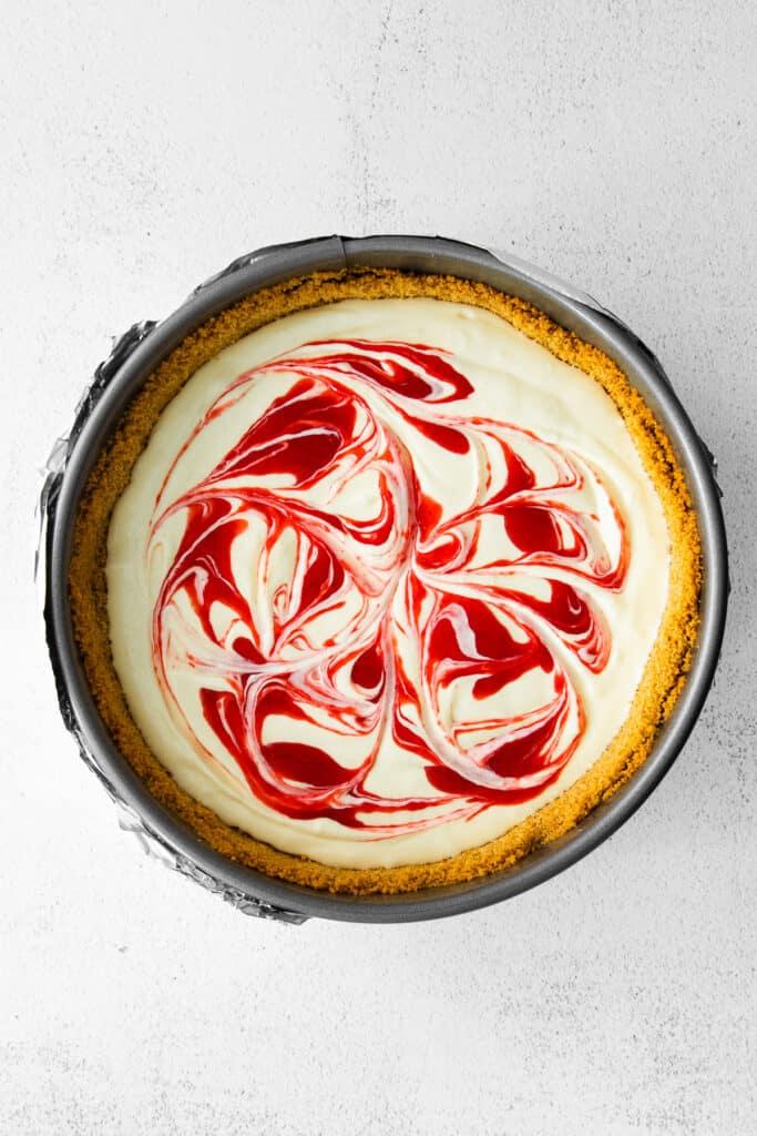 greek yogurt cheesecake topped with raspberry swirl