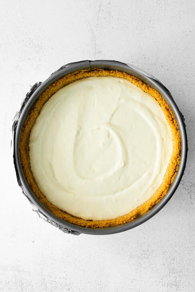 greek yogurt cheesecake in a spring form pan ready to be baked