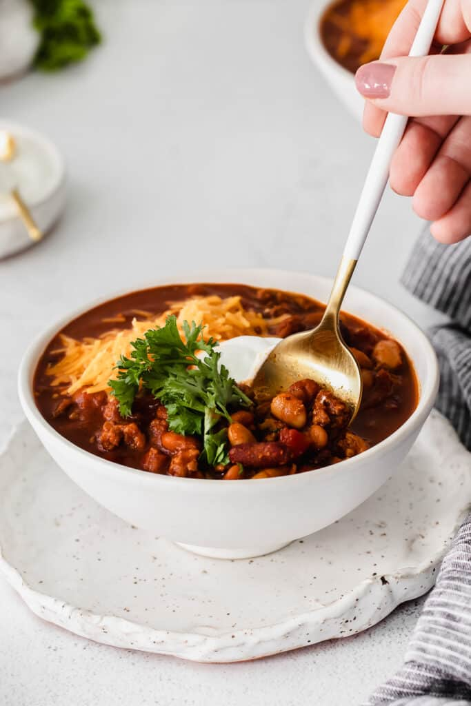 instant pot chili in a bowl with a spoon
