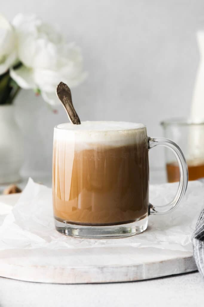miel latte in a coffee mug with a spoon