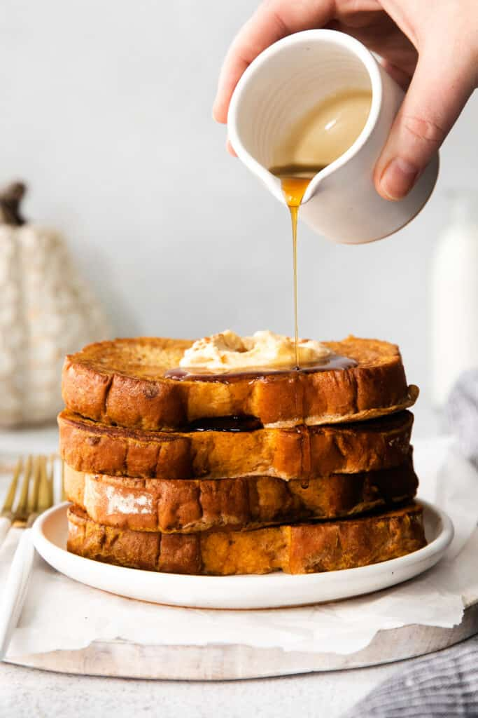 Pouring maple syrup over pumpkin french toast.