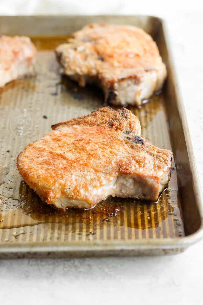 juicy oven baked pork chop on baking sheet