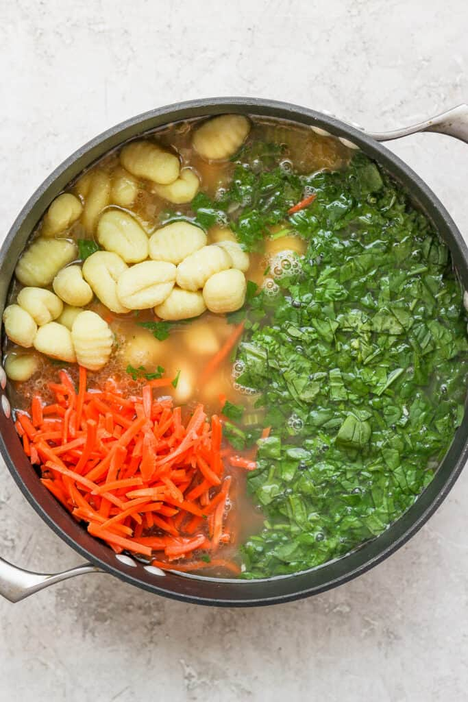 olive garden chicken gnocchi soup ingredients in a stock pot
