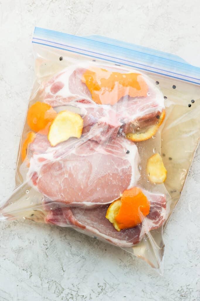 pork chops brining in bag