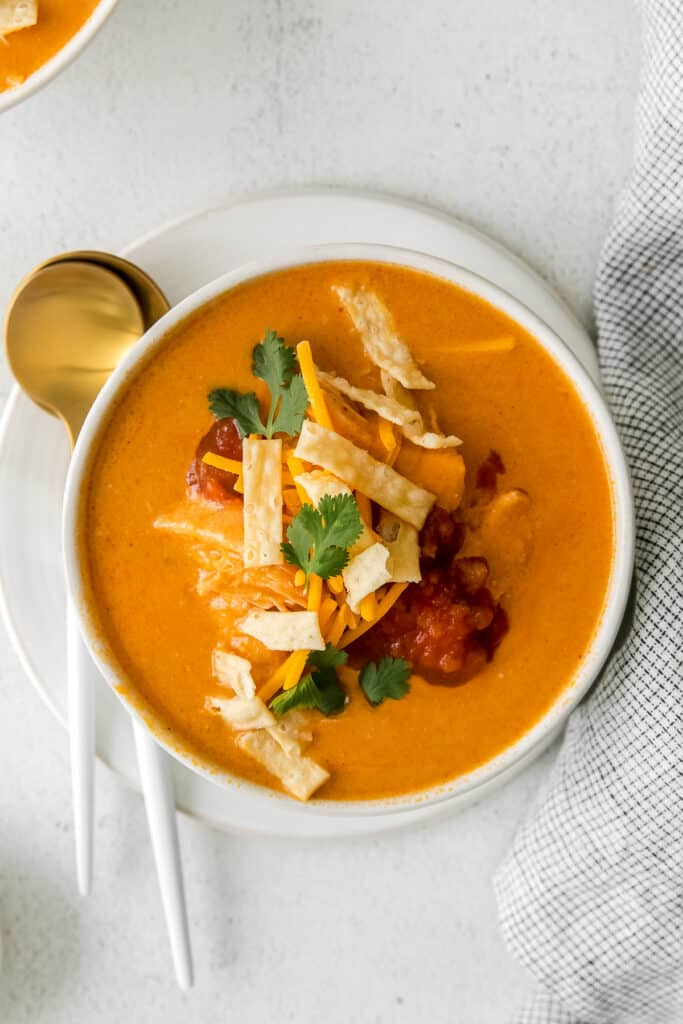 A bowl of Chilis Chicken Enchilada Soup.